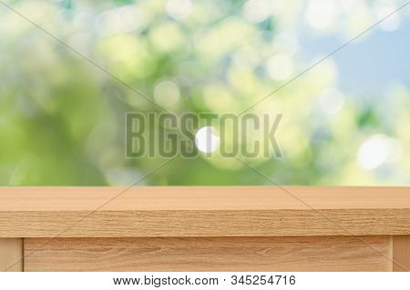 Emtpy Tabletop With Green Fresh Spring Blurred Background