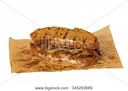 Sandwich Of Savory Ground Beef With Salted Cucumbers On Toasted Wholewheat Bread. A Delicious Variet