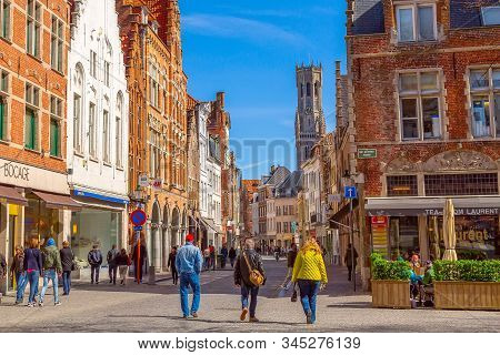 Bruges, Belgium - April 10, 2016: Street View With Medieval Traditional Houses And Belfort Tower In