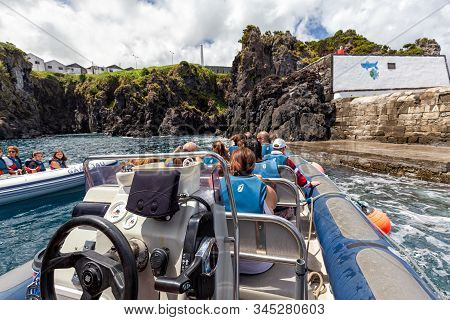 Santa Cruz Das Flores, Portugal - August 9: Unidentified Tourists On A Blue Boat Traveling To Corvo