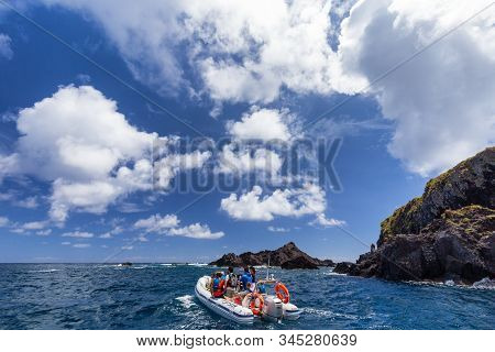 Santa Cruz Das Flores, Portugal - August 9: Unidentified People Relax On A Small Boat In The Clear W