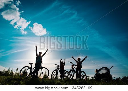 Happy Mother With Kids Biking At Sunset, Family Enjoy Bike Ride