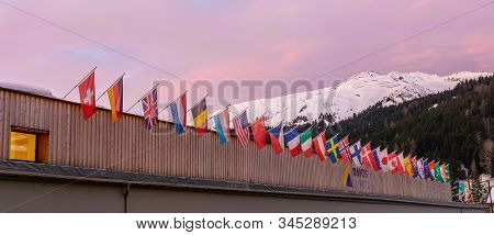 The Congress Center In Davos With Flags Of Nations At Sunrise During The Wef World Economic Forum