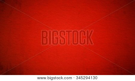 A Sheet Of Bright Red Paper With Light Vignetting Around The Edges. Passionate Red Color. Saturated