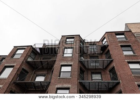 Rear View Looking Up Of Brick Brownstones With Metal Balconies, Horizontal Aspect