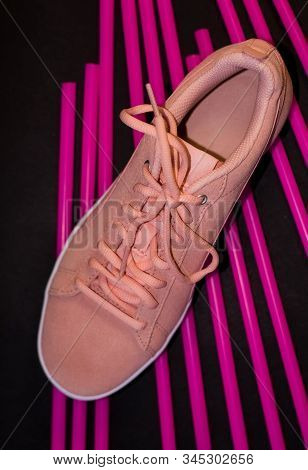 Womens Pink Sneakers. Sports And Comfortable Shoes. Modern Style And Fashion. Black Background With