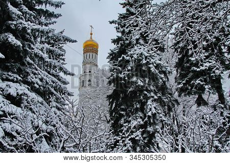 Ivan The Great Bell Tower - Russian Church On The Background Of Snow-covered Trees
