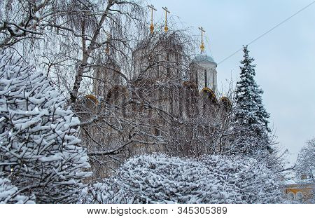 Beautiful Russian Church On The Background Of Snow-covered Trees