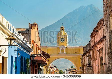 The Santa Catalina Arch And Agua Voclano In Antigua Guatemala, Guatemala