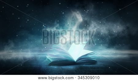 An Open Book On A Wooden Table Under The Night Sky Against A Dark Forest. Magical Radiance. Night Sc