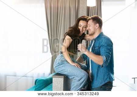 Young Smiling Beautiful Couple Man And Woman Looking Excited, Husband Gives Keys From Their New Appr