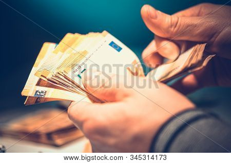 Caucasian Businessman Counting Euro Cash Money. Closeup Video.