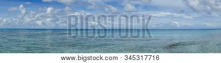 Panorama Of Blue Sky And Turquoise Water In The Pacific Ocean Off Bora Bora In French Polynesia; Lan