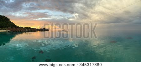 Panorama Of The Lagoon Around Bora Bora, French Polynesia With A Mountain And Overwater Bungalows; L