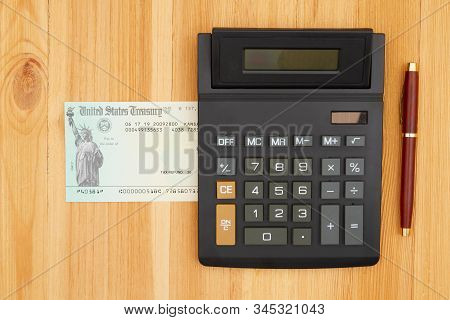 United States Treasury Check For Either A Federal Tax Refund Or Social Security Payment With A Calcu