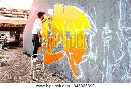 Street Artist Working On Colored Graffiti At Public Space Wall - Modern Art Perform Concept Of Urban