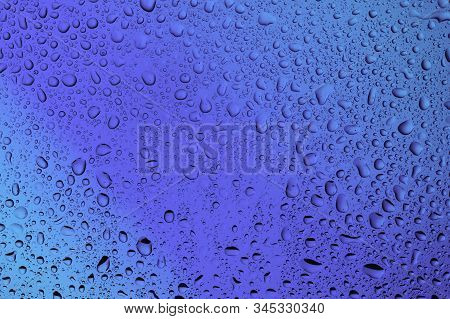 Water Bubbles On The Glass Close Up On A Beautiful Blue Background
