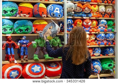 Minsk, Belarus - December 20, 2019: Buyer Chooses Toys Superheroes Of Marvel Universe Made By Miniso