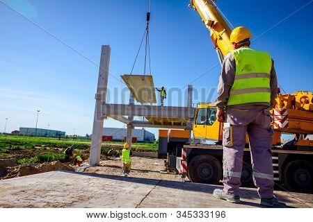 Zrenjanin, Vojvodina, Serbia - April 20, 2018: View From Behind On Construction Worker With Safety V