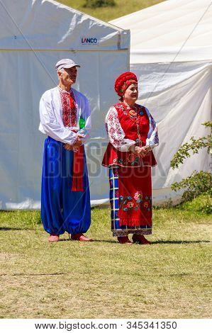 Dnipropetrovsk Region, Ukraine - June 2, 2018: Unknown People In Traditional Ukrainian Clothing Duri