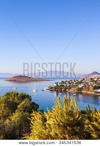 Aegean Coast With Marvelous Blue Water, Rich Nature, Islands, Mountains And Small White Houses