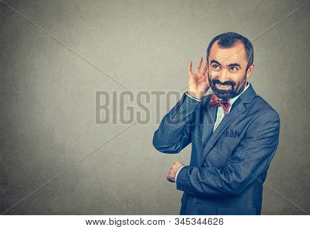 Man Eavesdropping Smiling Happy, Businessman With His Hand To His Ear Trying To Listen Smiling Happy