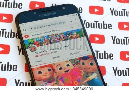 Cocomelon - Nursery Rhymes Official Youtube Channel On Smartphone Screen On Paper Youtube Background