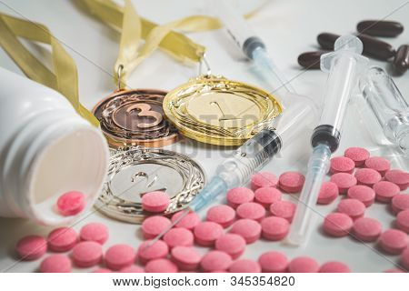 Pile Of Drugs In Pills And Injections And Sports Medals. Concepts Of Drug Usage And Doping In Sport
