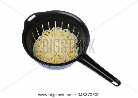 Top View Of A Black Plastic Colander Filled With Spaghetti Isolated On White Background.