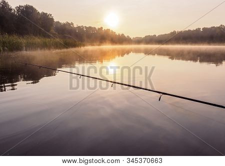 Silent Sunset Fishing. Fishing On The Inflatable Boat On The River An Sinrise In Early Morning. Infl