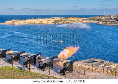 Valletta, Malta - January 9, 2020: Shot From Cannon At Noon In Saluting Battery At Upper Barrakka Ga