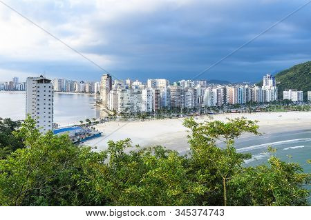 Coastal City With Many Tall Buildings Near To The Beach. Aerial View Of Sao Vicente City, Sp Brazil.