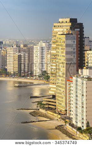 Tall Buildings Near To The Beach Of A Coastal City On A Sunset. Paulista Coast, Sao Vicente City - S