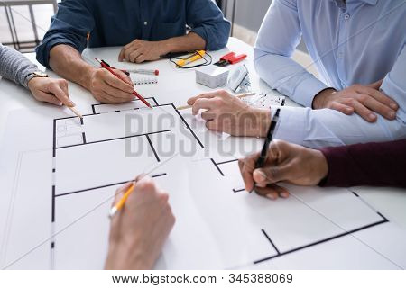 Elevated View Of An Architects Drawing Plan On Blueprint With Electrical Components