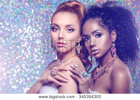 Beautiful models girls with set of Jewelry. Luxury girls in shine jewellry: Eearrings, Necklace, and Ring. Women in jewelry from Gold, Precious Stones, Siamonds. Beauty and accessories.