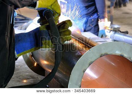 Welder Performs Welding Work Semi-automatic Electric Arc Welding. Stainless Steel Pipe Welding. Mig