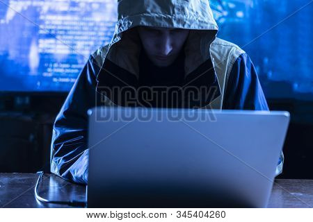 The Anonymous Hacker Braking The Personal Online Data In His Office, Dark Blue, Deep Web