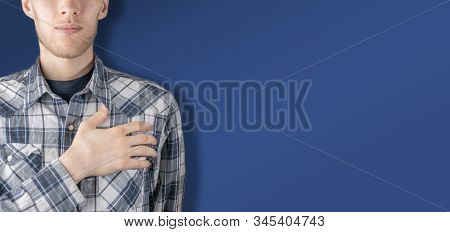 Male Person Holding His Hand To The Chest Heart, The Concept Of Trust And Respect Gesture Against Co