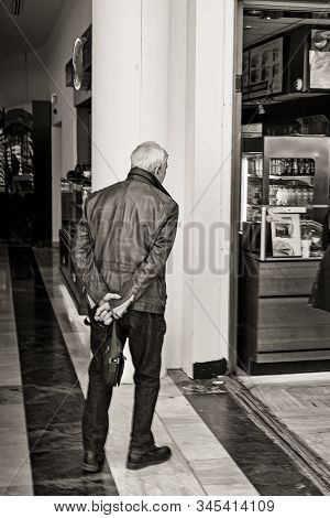 The Husband Waits While His Wife Gets Something From The Shop At A Mall In Serris, France. The Man S