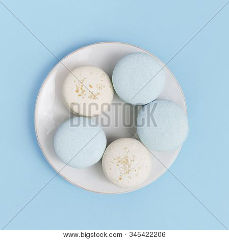 Top View On White Plate With Biscuits Macaroon. Sweet And Tasty Dessert Almond Cookies. Minimal Styl