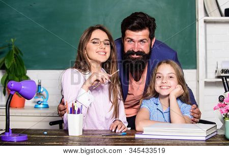 Extra Classes. Gifted Child. Little Girl Studying With Team Of Tutors. Private Lesson With Tutors. H