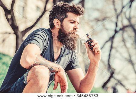 Bearded Man Smoking Vape. Smoking Electronic Cigarette. Smoking Device. Man Long Beard Relaxed With