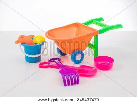 Colorful Beach Toy And Toy Cart Isolated On White Background