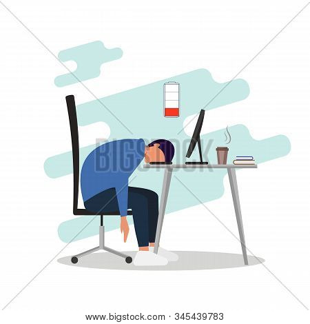 Professional Burnout Concept. Young Exhausted Male Manager Sits At Table In The Office, Long Work Da