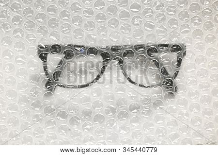 Abstract Bubble Wrap And Glasses, Close Up