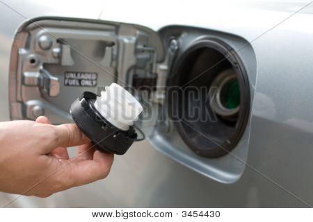 Fuel Filler Cap In Male Hand