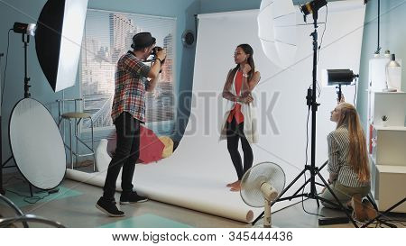 Photo Session In Modern Studio: Photographer Taking Photos Of The Black Model An