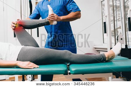 Chiropractor Doing An Exercise To Treat A Patients Knee. Knee Pain, Knee Injury