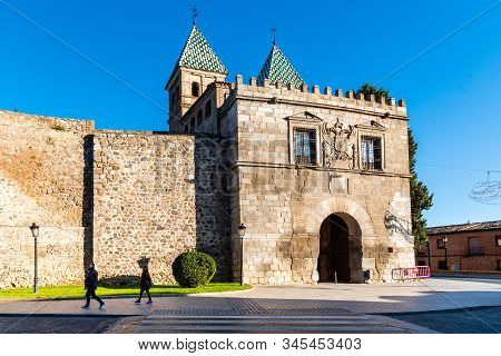 Toledo, Spain - December 6, 2019: The New Bisagra Gate In The Ramparts. View Against Blue Sky. It Wa