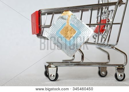 Supermarket Trolley And Rfid Tag. Shoplifting Prevention. Goods Security And Alarm. Free Space For A